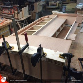 Special clamping cauls are used to clamp the veneer in place while the glue dries.