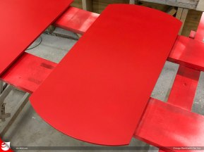"Rustoleum's ""Poppy Red"" spray paint on plywood."